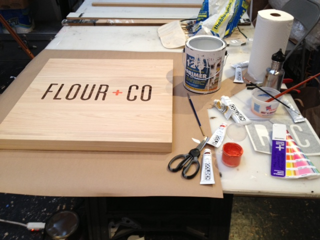 The work bench with the start of the hanging sign.