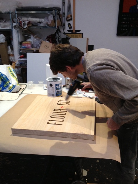Matt working on the hanging sign.