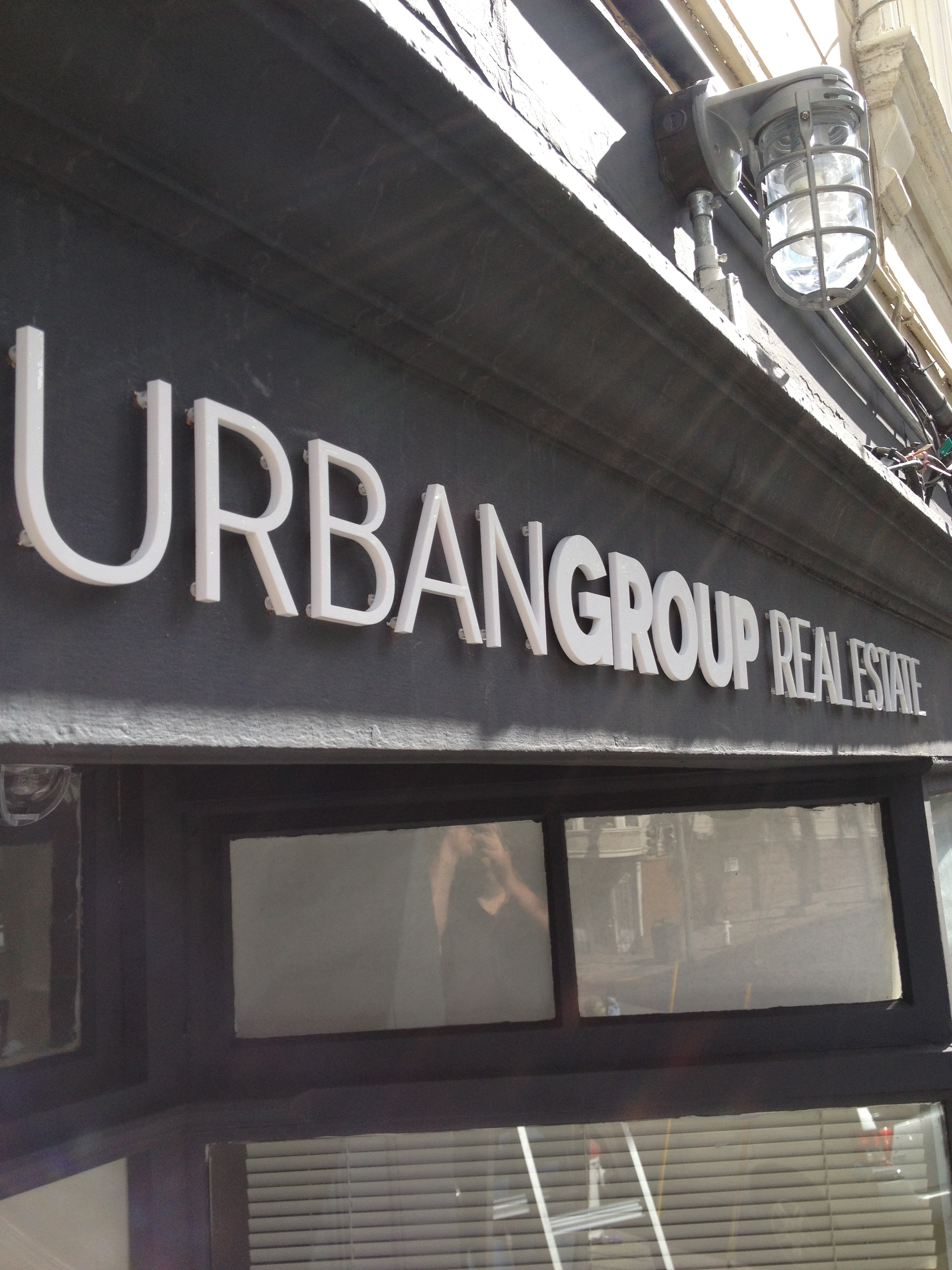 Urban Group Real Estate signs
